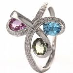 Ring, 18 carat white gold, with blue topaz green t